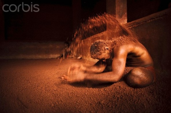 Indian wrestler throwing soil on himself