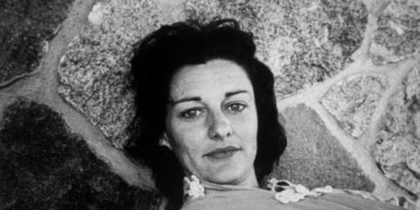 Poet Anne Sexton lying on stone patio. (Photo by Ian Cook//Time Life Pictures/Getty Images)